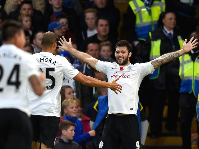 Charlie Austin of Queens Park Rangers celebrates his goal during the Barclays Premier League match between Chelsea and Queens Park Rangers at Stamford Bridge on November 1, 2014