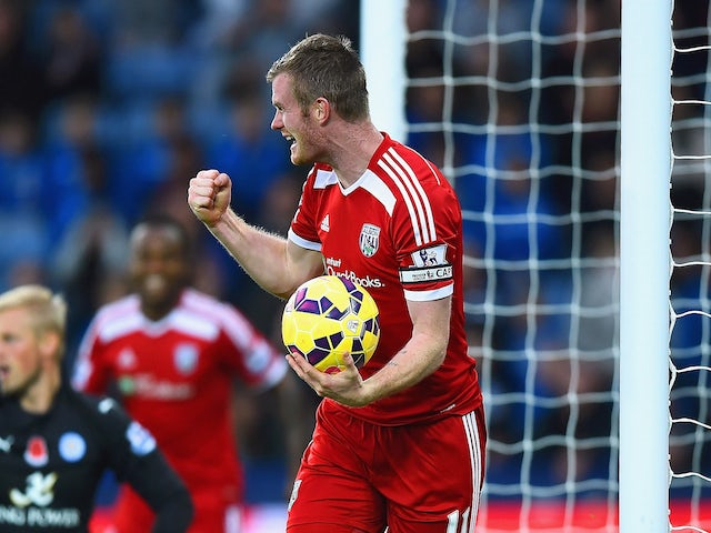 Chris Brunt of West Brom celebrates as he picks the matchball up from the net after Esteban Cambiasso of Leicester City scored an own goal on November 1, 2014