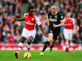 Danny Welbeck of Arsenal and David Jones of Burnley (R) in action during the Barclays Premier League match on November 1, 2014