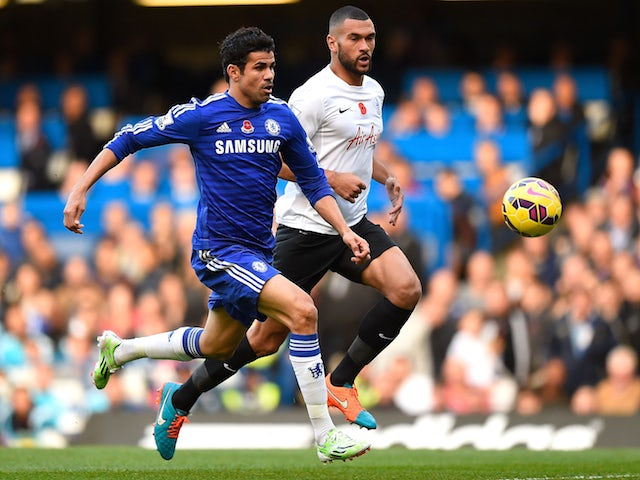 Diego Costa of Chelsea and Steven Caulker of Queens Park Rangers chase the ball during the Barclays Premier League match on November 1, 2014
