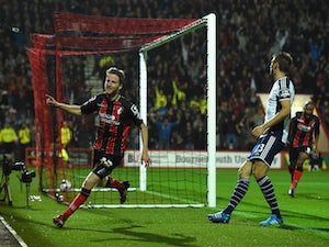 Bournemouth player Eunan O' Kane celebrates after opening the scoring during the Capital One Cup Fourth Round match against West Brom on October 28, 2014