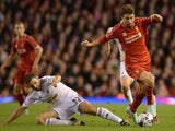 Fabio Borini of Liverpool is tackled by Angel Rangel of Swansea during the Capital One Cup Fourth Round match on October 28, 2014