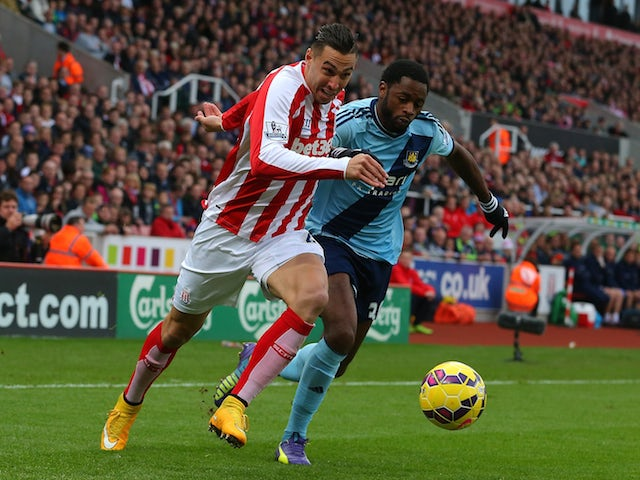 Geoff Cameron of Stoke City competes with Alex Song of West Ham during the Barclays Premier League match on November 1, 2014