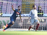 Gonzalo Higuain of Napoli celebrates after scoring the opening goal during the Serie A match between SSC Napoli and AS Roma at Stadio San Paolo on November 1, 2014