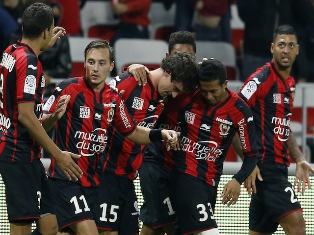 Nice's French defender Gregoire Puel (C) celebrates with teammates after scoring a goal during the French L1 football match against Lyon on November 1, 2014