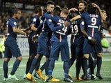 Paris Saint-Germain's Cameroonian midfielder Jean-Christophe Bahebeck (4th L) is congratulated by his teammates after scoring a goal during the French L1 football match against Lorient on November 1, 2014