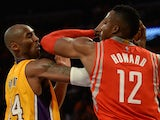 Kobe Bryant (L) of the Los Angeles Lakers and Dwight Howard (R) of the Houston Rockets clash during the Laker's first regular season NBA game, October 28, 2014