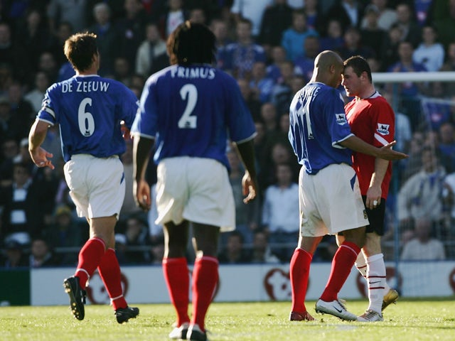 Wayne Rooney of Manchester squares up to Nigel Quashie of Portsmouth during the Barclays Premiership match between Portsmouth and Manchester United at Fratton Park, on October 30, 2004