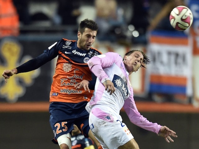 Montpellier's French defender Mathieu Deplagne (L) vies for the ball with Evian's French forward Nicki Nielsen (R) during the French L1 football match on November 1, 2014