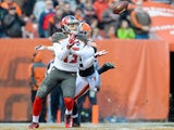 Wide receiver Mike Evans #13 of the Tampa Bay Buccaneers catches a touchdown pass while under pressure from defensive back K'Waun Williams #36 of the Cleveland Browns on November 2, 2014