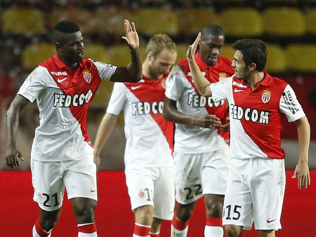Monaco's Nigerian defender Elderson Echiejile celebrates after scoring a goal with Monaco's midfielder Bernardo Silva during the French L1 football match Monaco (ASMFC) vs Reims (SR) at the Louis II stadium in Monaco, southern France on October 31, 2014