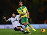 Gary O'Neil of Norwich City tackles Mark Davies of Bolton during the Sky Bet Championship match between Norwich City and Bolton Wanderers at Carrow Road on October 31, 2014