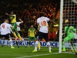 Cameron Jerome scores a goal for Norwich City during the Sky Bet Championship match between Norwich City and Bolton Wanderers at Carrow Road on October 31, 2014
