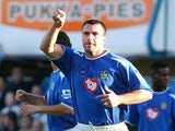 Portsmouth's David Unsworth celebrates after scoring from the Penalty spot against Manchester United, 30 October 2004