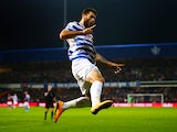 Charlie Austin of QPR celebrates scoring the opening goal during the Barclays Premier League match between Queens Park Rangers and Aston Villa at Loftus Road on October 27, 2014