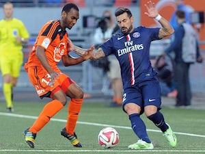 Lorient's French midfielder Raffidine Abdullah (L) vies with Paris Saint-Germain's Argentinian midfielder Ezequiel Lavezzi during the French first division L1 football match on November 1, 2014