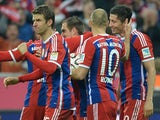 Bayern Munich's striker Thomas Mueller, defender Philipp Lahm, Dutch midfielder Arjen Robben celebrate after Polish striker Robert Lewandowski scored against Dortmund on November 1, 2014
