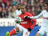 Romulo of FC Spartak Moscow challenged by Aleksandr Sheshukov of FC Lokomotiv Moscow during the Russian Premier League match between FC Spartak Moscow and FC Lokomotiv Moscow at the Arena Otkritie Stadium on October 26, 2014