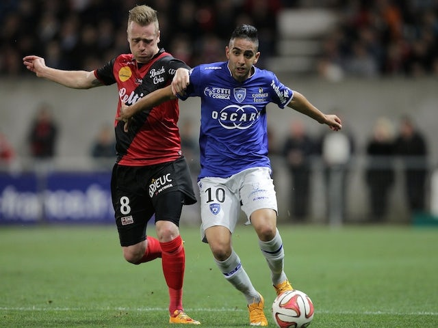 Guingamp's Danish forward Ronnie Schwartz (L) vies for the ball with Bastia's French Algerian midfielder Ryad Boudebouz (R) during the French L1 football match on November 1, 2014