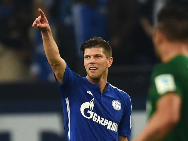 Schalke's Dutch striker Klaas-Jan Huntelaar celebrates scoring the 1-0 goal during the German First division Bundesliga football match FC Schalke 04 vs FC Augsburg in Gelsenkirchen on October 31, 2014