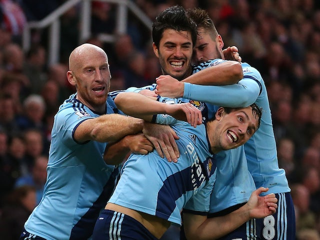 Stewart Downing of West Ham celebrates scoring his team's second goal with his team-mates during the Barclays Premier League match on November 1, 2014
