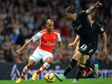 Arsenal's English striker Theo Walcott (L) vies with Burnley's Irish defender Stephen Ward (R) during the English Premier League football match on November 1, 2014