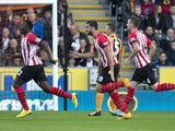 Southampton's Kenyan midfielder Victor Wanyama (L) celebrates scoring his team's first goal during the English Premier League football match against Hull City on November 1, 2014