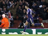 Anderlecht's forward from Serbia Aleksandar Mitrovic celebrates scoring his team's third goal during the UEFA Champions League Group D football match between Arsenal and Anderlecht at the Emirates Stadium in north London on November 4, 2014