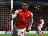 Alex Oxlade-Chamberlain of Arsenal celebrates as he scores their third goal during the UEFA Champions League Group D match between Arsenal FC and RSC Anderlecht at Emirates Stadium on November 4, 2014