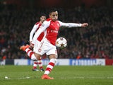 Arsenal's Chilean striker Alexis Sanchez scores his team's second goal during the UEFA Champions League Group D football match between Arsenal and Anderlecht at the Emirates Stadium in north London on November 4, 2014