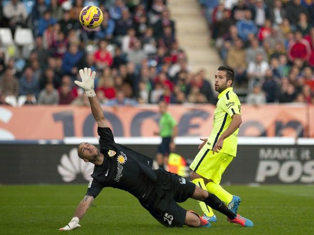 Barcelona's defender Jordi Alba scores during the Spanish league football match UD Almeria vs FC Barcelona on November 8, 2014