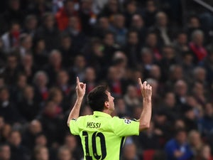 Record-equalling Messi sends Barcelona through