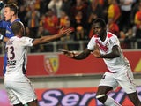 Bordeaux's Malian forward Cheick Diabate celebrates with Bordeaux's French forward Thomas Toure as Lens' French goalkeeper Valentin Belon reacts after Diabate scored his team's second goal during French L1 football match Lens vs Bordeaux on November 8, 20