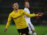 Dortmund's striker Marco Reus celebrates scoring during the UEFA Champions League second-leg Group D football match Borussia Dortmund vs Galatasaray AS in Dortmund, western Germany on November 4, 2014