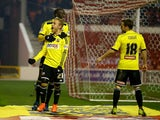 Alex Pritchard of Brentford celebrates scoring the third goal from the penalty spot during the Sky Bet Championship match between Nottingham Forest and Brentford at the City Ground on November 5, 2014