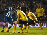 Kazenga Lua Lua of Brighton takes on the Wigan defence during the Sky Bet Championship match between Brighton & Hove Albion and Wigan Athletic at Amex Stadium on November 4, 2014