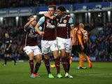 Ashley Barnes of Burnley celebrates scoring the opening goal with team mates during the Barclays Premier League match between Burnley and Hull City at Turf Moor on November 8, 2014