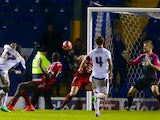 Nathan Cameron of Bury scores his sides second goal during the FA Cup First Round match between Bury and Hemel Hempstead Town at JD Stadium on November 8, 2014