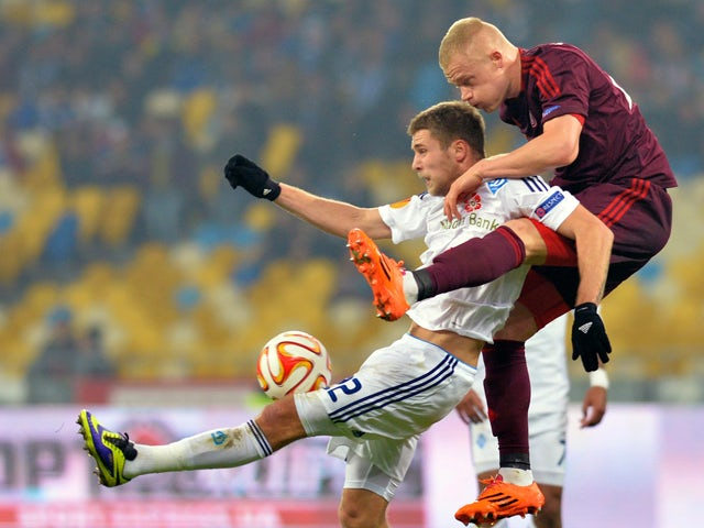 Aalborg BK's Rasmus Thelander fights for a ball against FC Dynamo Kyiv's Artem Kravets during their UEFA Europa League Group J match between FC Dynamo Kyiv vs Aalborg BK in Kiev on November 6, 2014