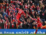 Emre Can of Liverpool celebrates scoring the opening goal during the Barclays Premier League match between Liverpool and Chelsea at Anfield on November 8, 2014