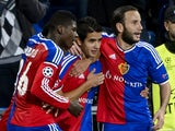 FC Basel's forward Derlis Gonzalez who scores the team's second goal is congratulated by teammates Cameroonian forward Breel Embolo and Albanian forward Shkelzen Gashi during to the UEFA Champions League Group B football match between FC Basel and Ludogor