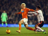 Bryan Ruiz of Fulham tackles David Perkins of Blackpool during the Sky Bet Championship match between Fulham and Blackpool at Craven Cottage on November 5, 2014