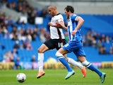 Jordan Bowery of Rotherham looks to get past Brighton's Gordon Greer during the Sky Bet Championship match between Brighton & Hove Albion and Rotherham United at The Amex Stadium on October 25, 2014