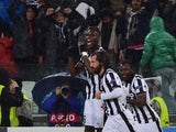 Juventus midfielder Andrea Pirlo celebrates after scoring a goal with Juventus french midfielder Paul Labile Pogba and Juventus midfielder of Ghana Kwadwo Asamoah during the UEFA Champions League Group A football match Juventus vs Olympiakos at the Juvent