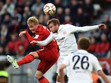 Mainz' Austrian midfielder Julian Baumgartlinger and Leverkusen's striker Julian Brandt vie for the ball during the German first division Bundesliga football match Bayer Leverkusen vs FSV Mainz 05 in Leverkusen, western Germany, on November 8, 2014