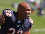 Matt Forte #22 of the Chicago Bears participates in warm-ups before a game against the Buffalo Bills at Soldier Field on September 7, 2014