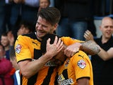 Kwesi Appiah of Cambridge celebrates with team mate and captain Michael Nelson after scoring his and the teams second goal of the game during the Sky Bet League Two match between Cambridge United and Oxford United at The Abbey Stadium on October 11, 2014