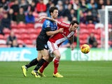 Lee Tomlin of Middlesbrough battles with Harry Arter of AFC Bournemouth during the Sky Bet Championship match between Middlesbrough and Bournemouth at Riverside Stadium on November 8, 2014