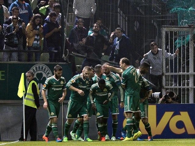 Panathinaikos Athens players and fans celebrate their goal against PSV Eindhoven during their group E UEFA Europa League match at the Apostolos Nikolaidis stadium in Athens on November 6, 2014