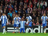 Porto's Colombian forward Jackson Martinez celebrates with his teammates after scoring during the UEFA Champions League football match Athletic Club Bilbao vs FC Porto at the San Mames stadium in Bilbao on November 5, 2014